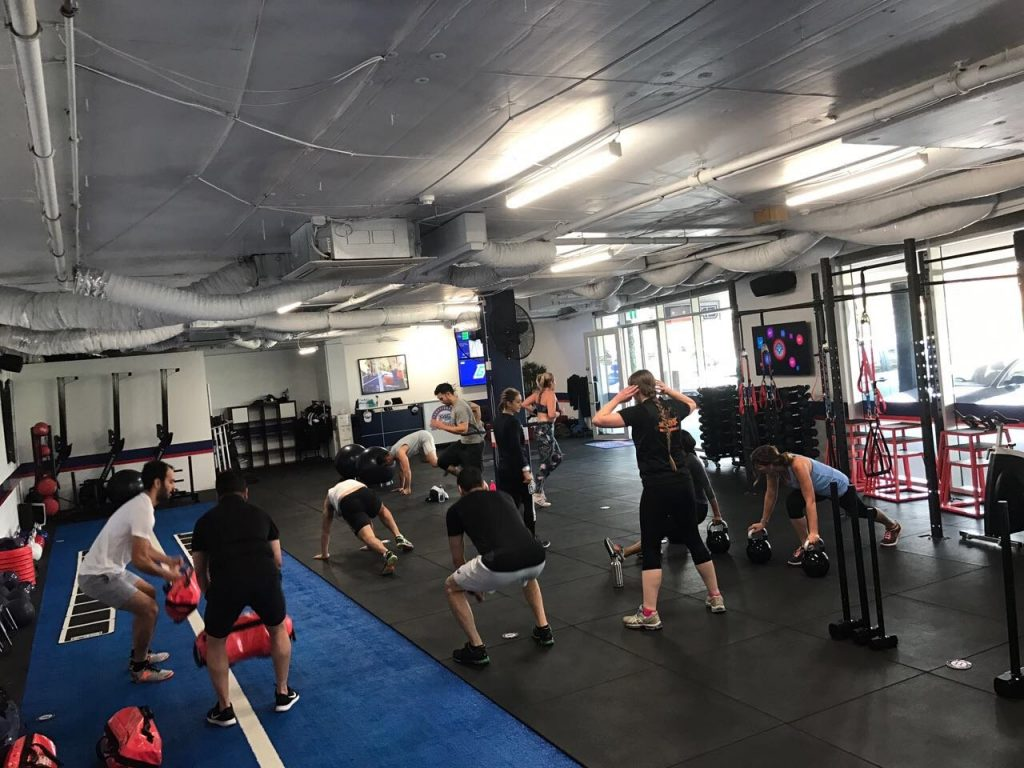 The Wellness Place team working out at F45!